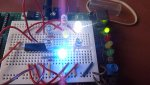 PICAXE-microcontroller-breadboarded-prototype-flashing-7-LED-desk-ornament-closeup-2-DHD.jpg